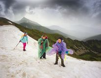 Children in a storm on the snow cornice Royalty Free Stock Photo