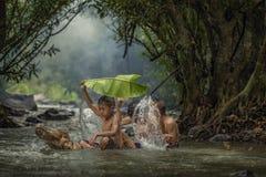 Children in the streams Stock Photo
