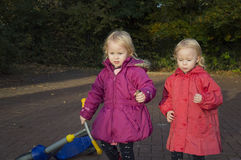 Children in the street. Children are walking on the street, two girls are twins Royalty Free Stock Image