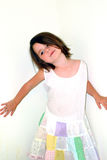 Children- Strike a Pose. Little girl playing and modeling against a white wall Royalty Free Stock Image