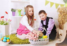 Children stroking rabbit Stock Photos
