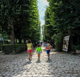 Children stroll along a cobbled path on the grounds of the Rodin museum Stock Photos