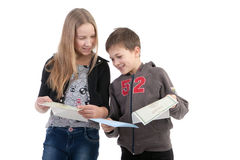 Children study the documents. On a white background Royalty Free Stock Image