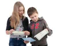 Children study the documents. On a white background Royalty Free Stock Photo
