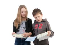 Children study the documents Royalty Free Stock Images