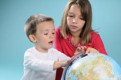 Children Studying Destinations On Globe Stock Photography