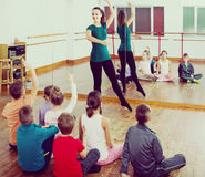 Children  studying folk style dance in class Royalty Free Stock Images