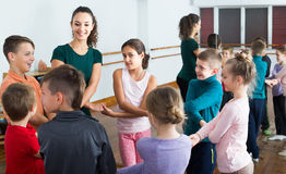 Children  studying folk style dance in class Royalty Free Stock Image