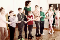 Children  studying folk style dance in class Stock Photography