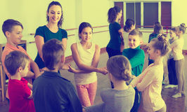Children  studying folk style dance in class Stock Photo
