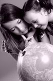Children studying globe Royalty Free Stock Photos