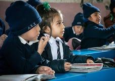 Children Studying in School in Asia