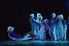 Children in a suit of penguins dance on a stage, Children`s danc Stock Photography
