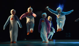 Children in a suit of penguins dance on a stage, Children`s danc Stock Photo