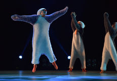 Children in a suit of penguins dance on a stage, Children`s danc Royalty Free Stock Photos
