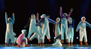 Children in a suit of penguins dance on a stage, Children`s danc Stock Images