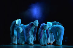 Children in a suit of penguins dance on a stage, Children`s danc Royalty Free Stock Image