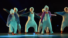 Children in a suit of penguins dance on a stage, Children`s danc Stock Photos