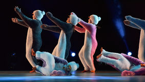 Children in a suit of penguins dance on a stage, Children`s danc Royalty Free Stock Images