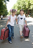 Children with suitcase run. Stock Photography
