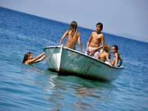 Children in summer fun on boat 3. Children (best friends) on school vacation, enjoy, swimming, sunbathing, on a small white board in Adriatic sea - Croatia Royalty Free Stock Photo