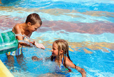 Children in summer outdoor pool. Royalty Free Stock Photos