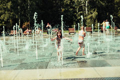 Children, summer. Children in the park bathed in the fountain Royalty Free Stock Images