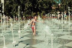 Children, summer. Children in the park bathed in the fountain Stock Images