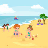 Children summer vacation. Kids Playing sand around water on beach Stock Image
