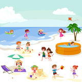 Children summer vacation. Kids Playing sand around water on beach Royalty Free Stock Photos