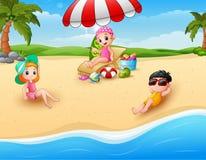 Children sunbathing on the beach Royalty Free Stock Photo