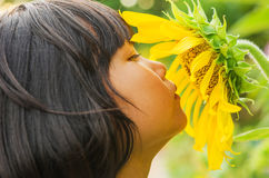 Children with sunflower in nature Royalty Free Stock Photo