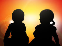 Children at sunset Stock Photography