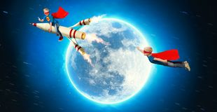 Children in superhero costumes fly in space and show super abilities. stock images