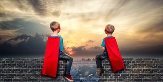 Children in superhero costumes guard the order in the city royalty free stock photography