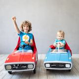 Children superheroes playing at home royalty free stock photography