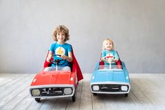 Children superheroes playing at home stock photo