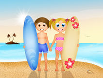 Children with surf on the beach Stock Images