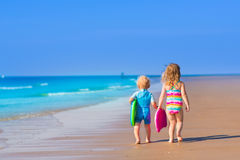 Children with surf boards on tropical beach Royalty Free Stock Photo
