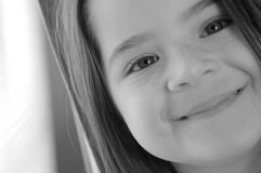 Children- Sweet Smile. Close up black and white image of a cute smiling girl Royalty Free Stock Photo