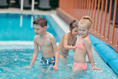 Children swim in the pool Royalty Free Stock Image
