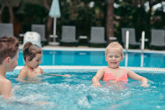 Children swim in the pool Royalty Free Stock Images