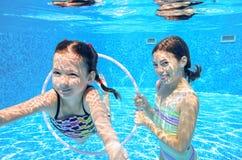 Children swim in pool underwater Stock Image