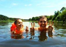 Children swim. Brothers have fun in the water. royalty free stock images