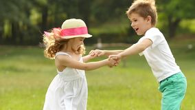 Children swim in the summer park, they are happy and cheerful. Slow motion