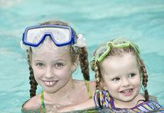 Children swim in swimming pool. Royalty Free Stock Images