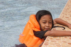 Children Swiming. An Indonesian little girl was swimming Stock Images
