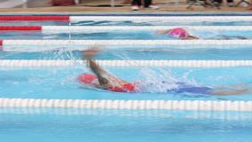 Children are swimming. BANGKOK CITY, THAILAND - July 19, 2015: Unknown child, Children are swimming. The swimming competition, Elementary School Students stock video footage
