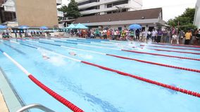Children are swimming. BANGKOK CITY, THAILAND - July 19, 2015: Unknown child, Children are swimming. The swimming competition, Elementary School Students stock video