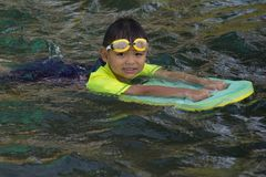 Children swimming. Boy Practice Swimming. Activities on the pool. Playing in water, happiness and holiday stock image